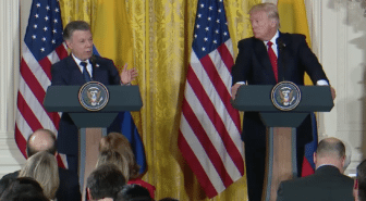 Juan Manuel Santos and Donald Trump speak at podiums in the White House with reporters in attendance