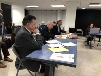 Attorney Clint Krislov, center, defends his Supreme Court candidacy before the Cook County Electoral Board on Thursday.