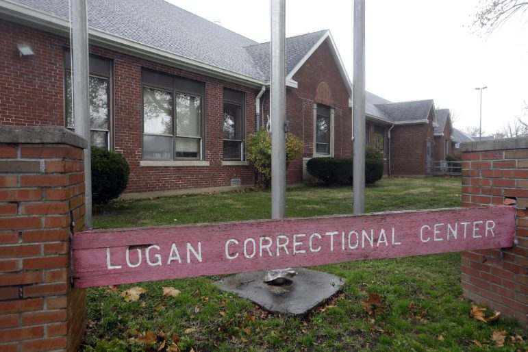 A sign reading Logan Correctional Center in front of a one-story brick building